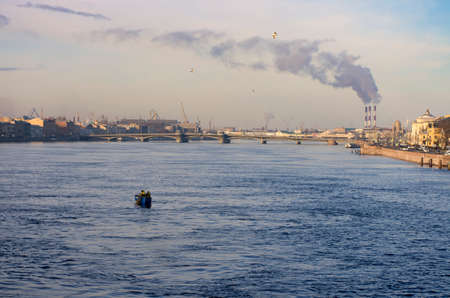 Fishing boat at sunrise on the Neva river on the background of the Annunciation bridge, and of Smoking pipes companies