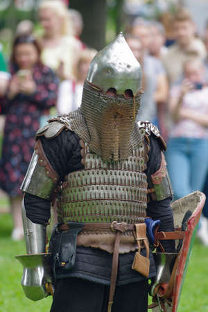historical events: Saint Petersburg, Russia - July 13, 2017: The Third Historical and Cultural Festival For Russia and Russian piety. Knight in steel armor with a shield in hand