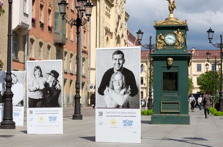 attract attention: St. Petersburg, Russia - July 23, 2017: Posters with a charity project to help children with Downs syndrome, in which celebrities from Russia