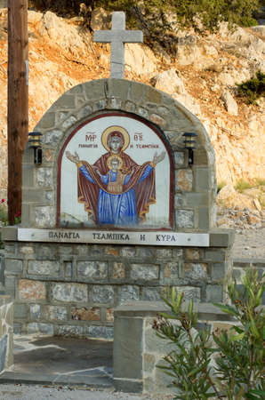 tsambika: Sign with a picture of the virgin Panagia Tsampika at the crossroads, announcing the proximity to the monastery and the church (Rhodes, Greece) ..