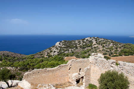 Ruins of the medieval castle of Kastellos in Kritinia with a beautiful view of the blue sea on the island of Rhodes (Greece).