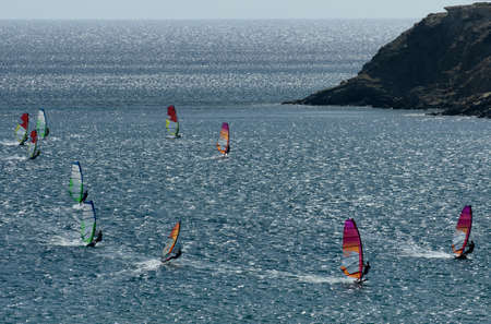 Windsurfers on the waves of the Mediterranean sea at Cape Prasonisi, Rhodes (Greece)