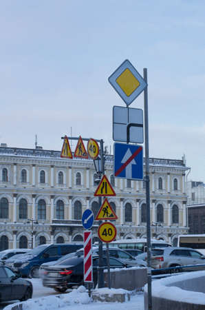 Many road signs warning of repairs, road narrowing and speed limit in the city