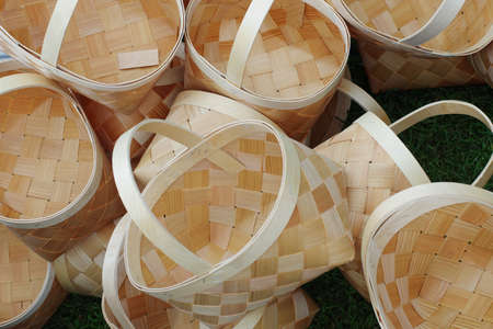 Large wicker striped baskets with handles made of hand-made wooden materials