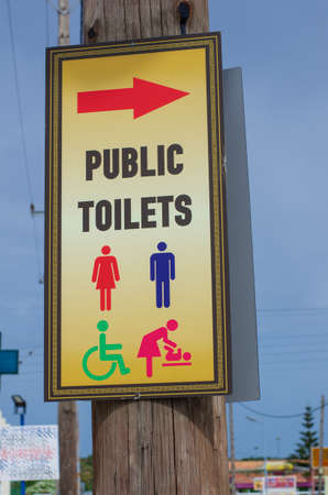 Road sign with widely known symbols and the inscription public toilets closeup (Greece)
