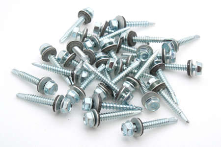 Set of screws scattered on a white background