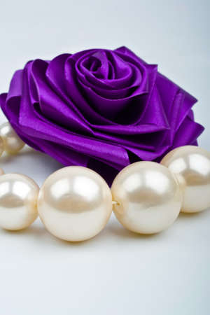 pearls and artificial roses Stock Photo