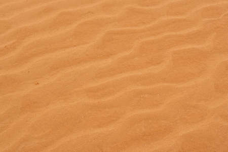 A close-up photograph of corrugated drawing on the sand of the desert. Stock Photo