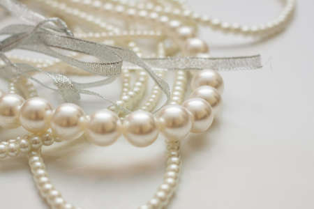 Cultured pearls on white background shallow dof
