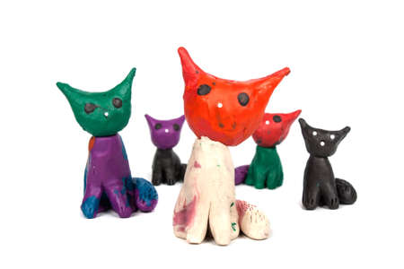 Group of colorful plasticine cats isolated on a white background