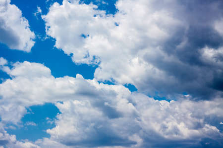 Bright clouds in the blue summer sky