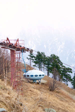 Ski lift in the mountains of the Northern Caucasus in the autumn foggy weather Stock Photo