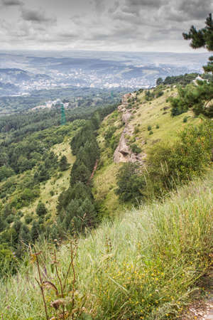 Cloudy weather in the mountains of the Northern Caucasus in the town of Kislovodsk. The view from the mountain.
