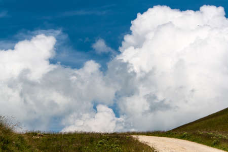 Clouds on the blue sky in a mountainous area