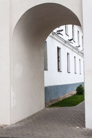 The passage in the form of an arch in the wall of the old city Minsk Belarus
