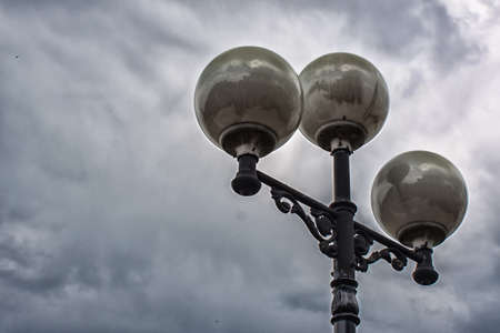 The lights on the pole in the background of a stormy sky Stock Photo