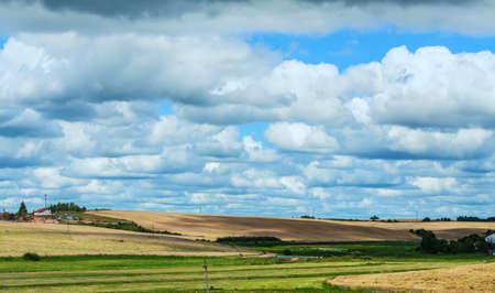 Summer rural landscape of Belarus, under a cloudy sky