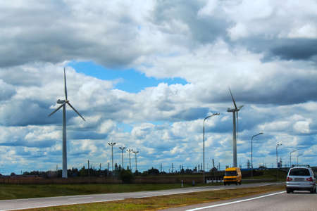Wind turbines standing along the road in the countryside of Belarus