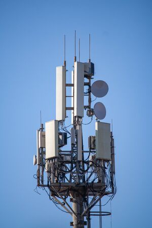 Tower with cellular antennas on the background of the sky