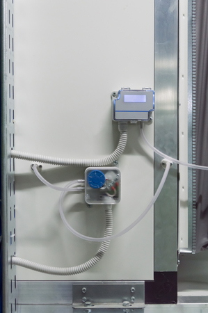 Photo of the display of industrial differential pressure sensor placed on the air handling unit body