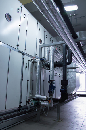 Side view of the huge industrial air handling unit in the ventilation plant room Stock Photo