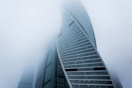 Atmosperic photography of the skyscrapers outgoing to the foggy sky