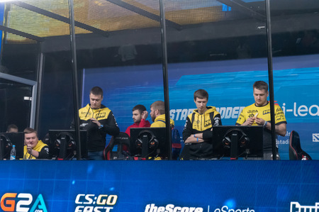 MINSK, BELARUS - JANUARY 17, 2016 Starladder championship of Dota 2 and Counter Strike: Global Offensive. NaVi team preparing to the competition in the gamiers cabin.
