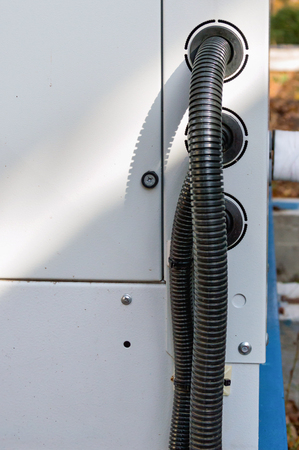 View of the wires connected to the industrial cooling unit for central ventilation system Stock Photo