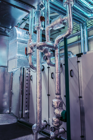 Industrial glycol pipeline insulated with metallic foil Stock Photo