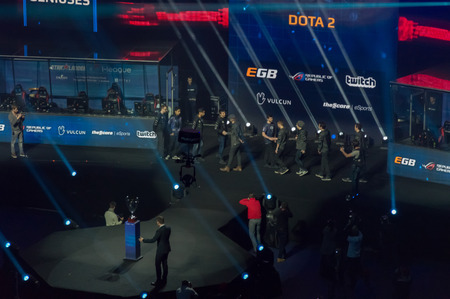 MINSK, BELARUS - JANUARY 17, 2016 Starladder iLeague championship Dota 2 and Counter Strike Global Offensive. Evil Genius and Alliance team shaking the hands before the on the stage before the battle.