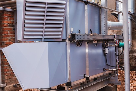 Side view of the commercial central air handling unit with cooling coil