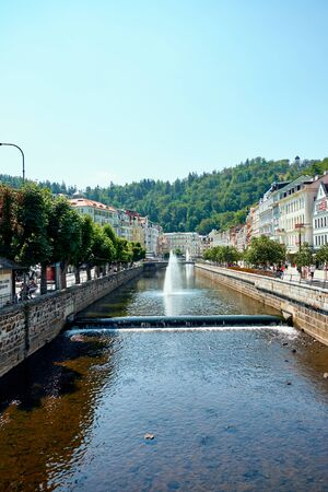 KARLOVY VARY, CZECH REPUBLIC - AUGUST 04, 2018 Perspective view of the outgoing river Tepla in the city center of Carlovy Vary