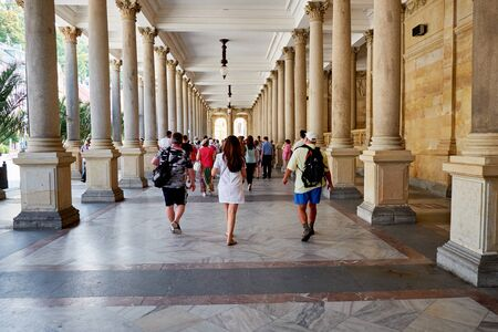 KARLOVY VARY, CZECH REPUBLIC - AUGUST 04, 2018 Tourists walking the PRINCE WENCESLAS SPRING, the 8th mineral spring, colonade in Carlovy Vary