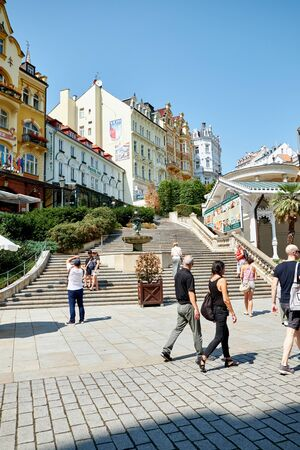 KARLOVY VARY, CZECH REPUBLIC - AUGUST 04, 2018 Tourists walking the city center in Karlovy Vary.
