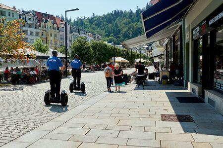 KARLOVY VARY, CZECH REPUBLIC - AUGUST 04, 2018 Police riding the segways in Karlovy Vary Redactioneel