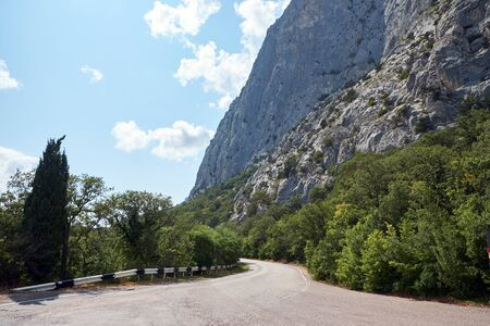 Road in the mountains going along the cliffs. Stockfoto