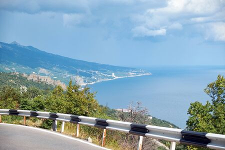 Road in the mountains going along the coastline.