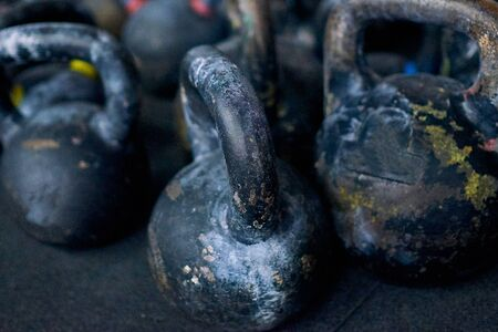 Close-up view of pile of the kettlebells for crossfit. Kettlebells can be used for exercises like swings, jerks and squats. Stockfoto