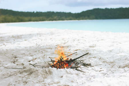 Small Campfire on the Wight Sandy Beach During the Summer on Tropical Island. Thailand.