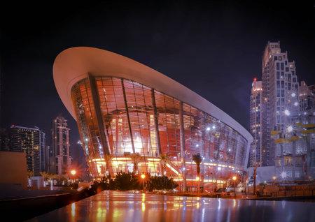 UAE December 252018 Dubai opera, night skyline. Holiday uae. City top view. Architecture building. Blue sky. 新聞圖片