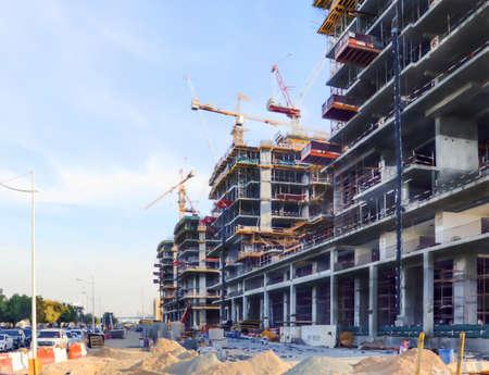 Dubai, UAE December 252018 Construction site on blue background. Skyline, cityscape. Urban cityscape. Building machineryon sky blue background. United arab emirates.