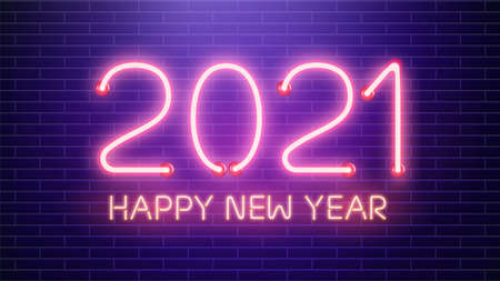 2021 Happy New Year neon lamps on brick wall.