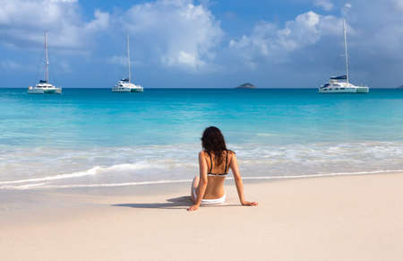 Young girl on the beach of Seychelles photo