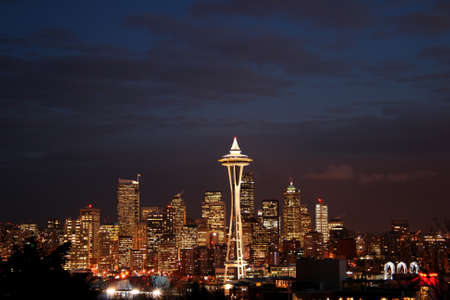 space needle: Lights of Seattle downtown in the twilight transition into night
