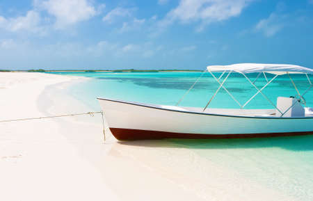 venezuela: Boat at the tropical beach of Cracqui, Los Roques Stock Photo