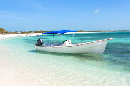 Boat at the tropical beach Stock Photo