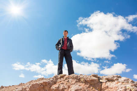 rock bottom: Bottom view of the man standing on a rock Stock Photo