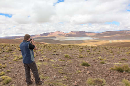 Man taking pictures of Bolivian altiplano photo