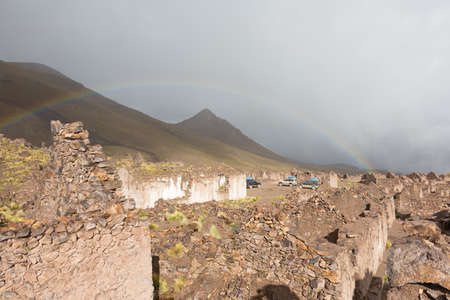 blasted: The ruins of the ancient village of San Antonio de Lipez in Bolivia with rainbow