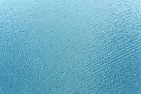 swell: Sea surface background with ripple and reflection of sunlight from above Stock Photo